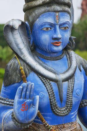 gujarat: Exterior detail of the Shiva statue at Ganga Talao Grand Bassin Hindu temple, Mauritius. Its a copy of the Shiva statue of Sursagar Lake in Vadodara, Gujarat, India. Stock Photo