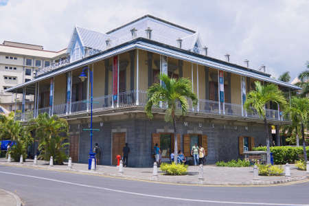 indian postal stamp: Port Louis, Mauritius - November 29, 2012: Exterior of the Blue Penny museum building in Port Louis, Mauritius. Editorial