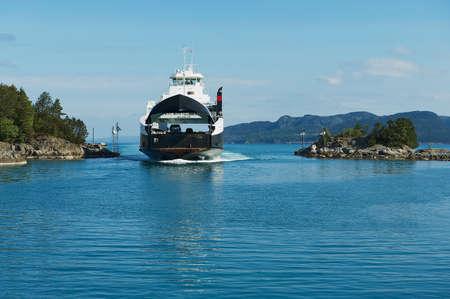 Tveit, Norway - June 06, 2010: Ferry boatz arrives to the port in Tveit, Norway. Editöryel