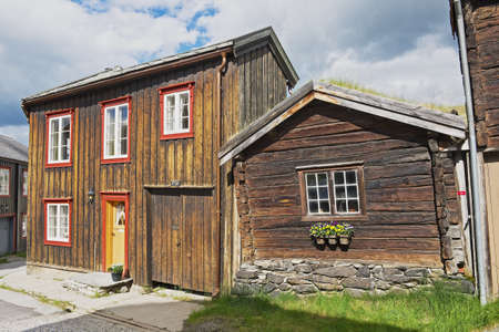 declared: Roros, Norway - June 24, 2013: Exterior of the traditional timber houses of the copper mines town of Roros, Norway. Roros town is declared a UNESCO World Heritage site.