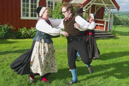 june 25: Roli, Norway, June 25, 2013 - People wearing historical costumes perform traditional dance in Roli, Norway.