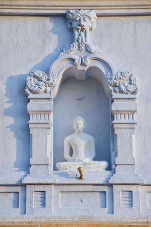 stupa one: Exterior of the Buddha statue at Ruwanwelisaya stupa in Anuradhapura, Sri Lanka. Ruwanwelisaya is a sacred place for Buddhists and one of the largest stupas in the world.