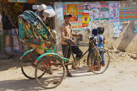 insurgency: Bandarban, Bangladesh, February 20, 2014 - Rickshaw waits for passengers at the street in Bandarban, Bangladesh. The remote and least populated in the country Bandarban area became one of the most exotic tourist destination of Bangladesh after insurgency