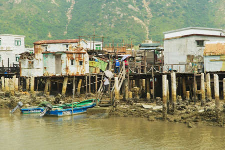motorboats: Hong Kong, China - September 15, 2012: Exterior of the Tai O fishermen village with stilt houses and motorboats in Hong Kong, China. Tai O is a famous tourist destination in Hong Kong.
