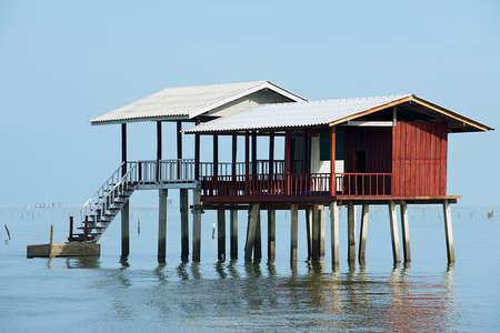 surat: View to the stilt fishermen cabin in the gulf in Tha Thong, Surat Thani province, Thailand. Stock Photo