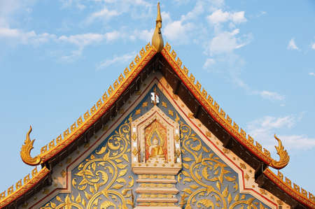 khan: Chiang Khan, Thailand - April 17, 2010: Exterior detail of the Wat Sri Khun Mueang temple in Chiang Khan, Thailand.