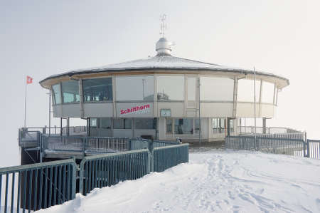 secret place: Murren, Switzerland - December 08, 2009: Exterior of the Piz Gloria revolving restaurant on a winter cloudy day circa Murren, Switzerland. Piz Gloria is the place, where the James Bond movie On Her Majestys Secret Service was set.