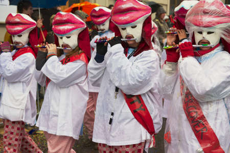 clique: BASEL, SWITZERLAND - MARCH 02, 2009: Unidentified women play flutes at Basel Carnival in Basel, Switzerland.