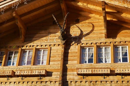 clowds: Brienz, Switzerland - December 08, 2009: Exterior of a traditional Swiss wooden chalet in Brienz, Switzerland.