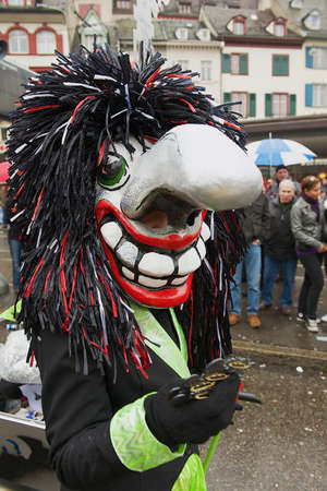 fasnacht: Basel, Switzerland, March 02, 2009 - Person wears Waggis mask at Basel Carnival in Basel, Switzerland.