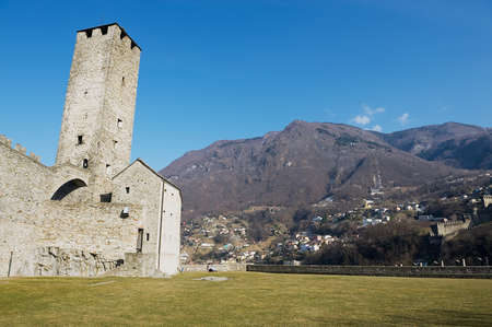 the medieval: Bellinzona, Switzerland - February 18, 2012: View to the tower of the Castelgrande castle in Bellinzona, Switzerland. UNESCO Worls Heritage site. Editorial