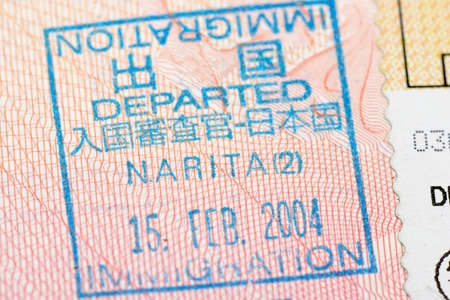customs official: Passport page with the Japan departure immigration control stamp at the Narita airport.