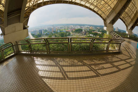 wide angle lens: Kuching, Malaysia - August 26, 2009: View to the Kuching city from the TV tower in Kuching, Malaysia. Filmed with a wide angle lens.
