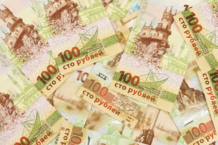 incorporation: Set of one hundred Russian rubles banknotes with Crimea symbolics. Special banknote edition dedicated to incorporation of the Crimea region into Russian Federation. Stock Photo