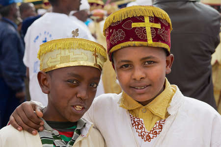 Addis Ababa, Ethiopia, January 18, 2010 - Portrait of two Ethiopian boys wearing traditional costumes during Timkat Christian Orthodox religious celebrations in Addis Ababa, Ethiopia.