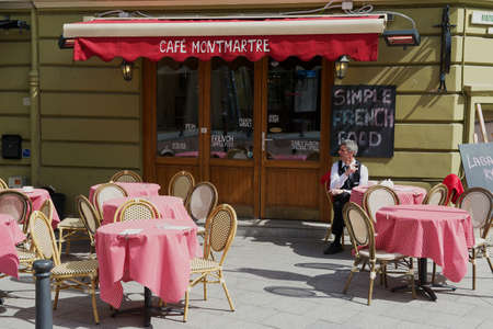 frence: Vilnius, Lithuania, May 02, 2015 - Man sits at the table at the Cafe Montmartre in downtown Vilnius, Lithuania.