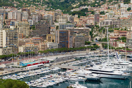 Monaco, Monaco - June 17, 2015: View to the buildings and marina of Monte Carlo from the viewpoint at the Princes Palace of Monaco (Monaco - Ville) in Monaco, Monaco.
