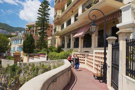 Monaco, Monaco, June 17, 2015 - People walk by the seaside passage in the historical part of Monaco.