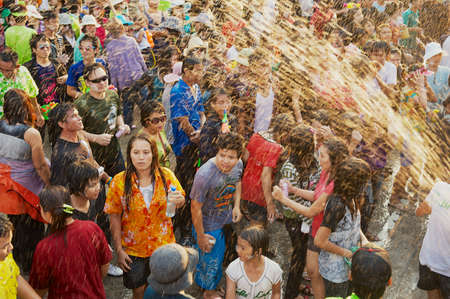 Khon Kaen, Thailand, April 13, 2010 - Young people celebrate traditional Songkran festival at the street.