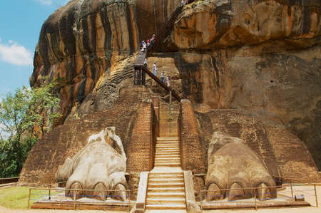 Sigiriya, Sri Lanka, May 20, 2011 - Tourists climb Sigiriya Lion rock fortress in Sigiriya, Sri Lanka. Sigiriya is listed as UNESCO World Heritage Site. Editorial