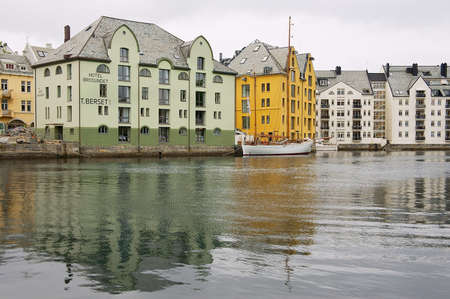 Alesund, Norway - June 03, 2010: View to the historical buildings in the harbor of Alesund, Norway.