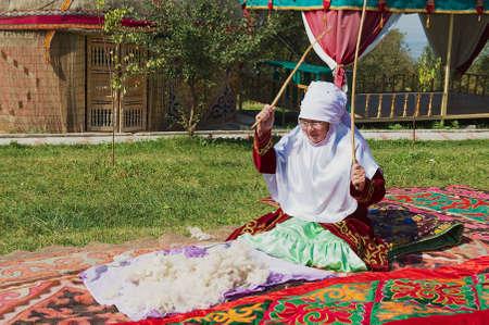 Almaty, Kazakhstan, September 18, 2011 - Women wearing traditional dress. Editorial
