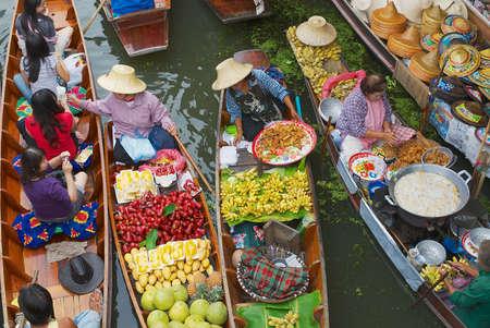 Damnoen Saduak, Thailand, May 15, 2008 - Women sell food from boats at the floating market in Damnoen Saduak, Thailand.