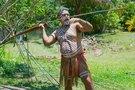Kuranda, Australia, November 07, 2007 - Aborigine actor throws a spear in the Tjapukai Culture Park in Kuranda, Queensland, Australia. Editorial