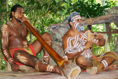 Kuranda, Australia, November 07, 2007 - Aborigine actors perform music with traditional instruments in the Tjapukai Culture Park in Kuranda, Queensland, Australia. Editorial
