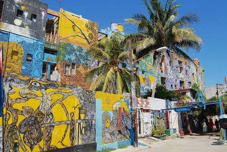 Havana, Cuba - October 22, 2006: Building exterior with the street art paintings in Havana, Cuba. Popular tourist location Salvador Gonzalez.