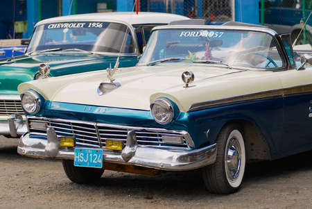 Havana, Cuba - October 21, 2006: Vintage Ford and Chevrolet cars parked at the street in Havana, Cuba. Editorial