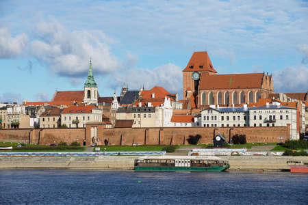 Torun, Poland - September 23, 2013: View to the old town of Torun from across the Vistula river in Torun, Poland. Old Torun is declared a UNESCO World Heritage site.