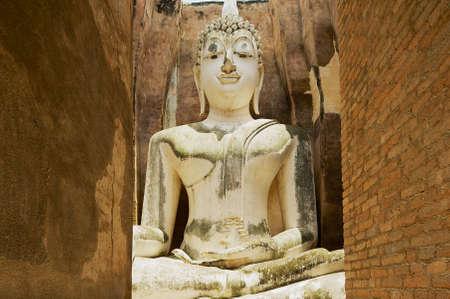SUKHOTHAI, THAILAND - AUGUST 22, 2011: Exterior of the White Buddha statue in Wat Sri Chum temple in Sukhothai Historical park in Sukhothai, Thailand.