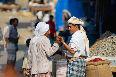 Sanaa, Yemen, September 18, 2006 - Two senior men talk at the street market in Sanaa, Yemen. Editorial