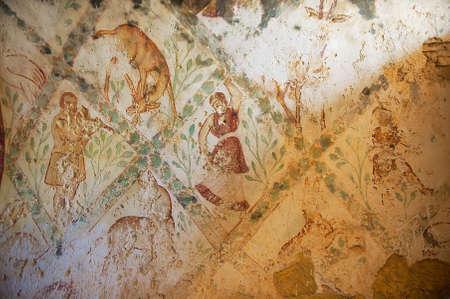 Zarqa, Jordan - August 23, 2012: Fragment of the Roman mural wall at an ancient Umayyad Desert Castle of Qasr Amra in Zarqa, Jordan