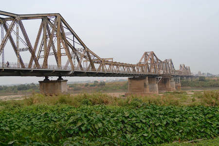 Hanoi, Vietnam - Fabruary 09, 2007: View to the Long Bien bridge in Hanoi, Vietnam. First steel bridge across the Red River, built by the French (1898-1902).