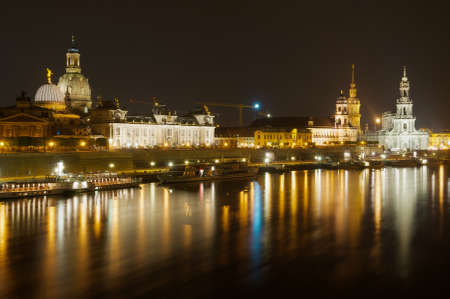 Dresden, Germany - May 22, 2010: Night view of the city with the Royal Palace and Frauenkirche cathedral buildings and reflections in the Elbe river in Dresden, Germany.