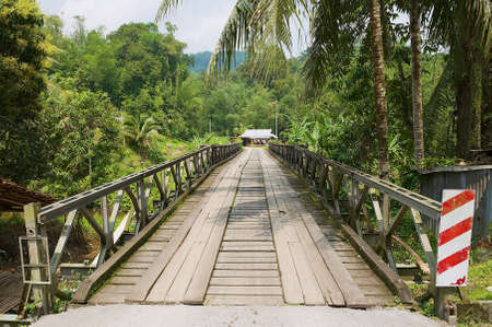 Kuching, Malaysia - August 27, 2009: View to the bridge leading to the Annah Rais Bidayuh village in Kuching, Malaysia.