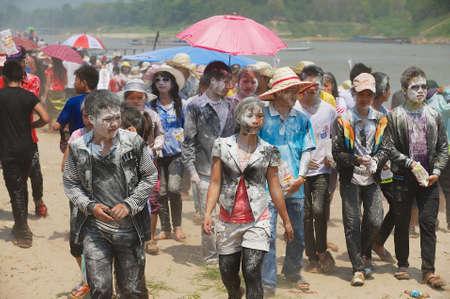 Luang Prabang, Laos, April 13, 2012 - Young people celebrate Laotian New Year in Luang Prabang, Laos. Splashing flour at someones face. Redactioneel