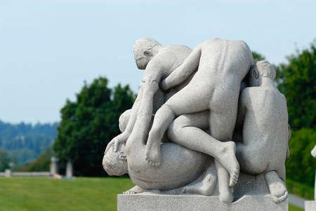 Oslo, Norway - July 06, 2006: Granite sculpture made by the famous artist Gustav Vigeland in open air Frogner park in Oslo, Norway. Redactioneel