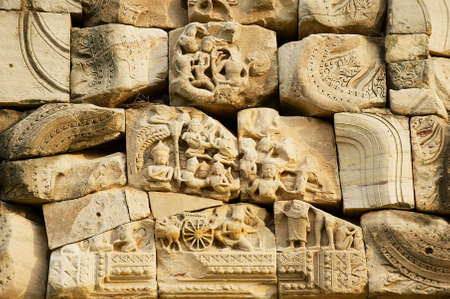 Sandstone carving with religious motifs at the ruins of the Hindu temple in Phimai historical park (Prasat Hin Phimai) in Thailand. Editoriali