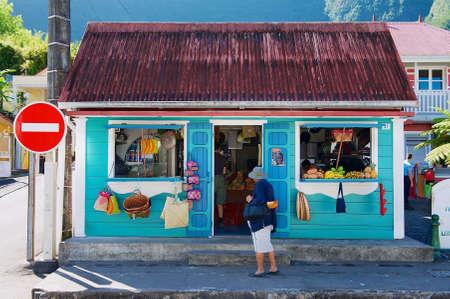 Saint-Denis De La Reunion, France - December 07, 2010: Colorful souvenir and fruit shop building at the town of Fond de Rond Point in Saint-Denis De La Reunion, France. Editorial