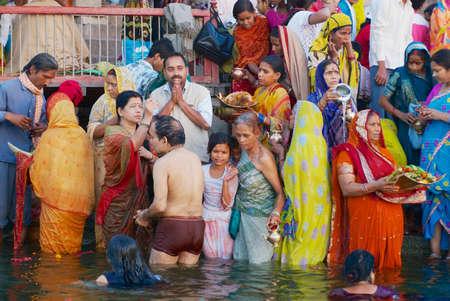 Varanasi, India - March 25, 2007: Unidentified pilgrims bathe in Holy Ganges river at sunrise in Varanasi, India.