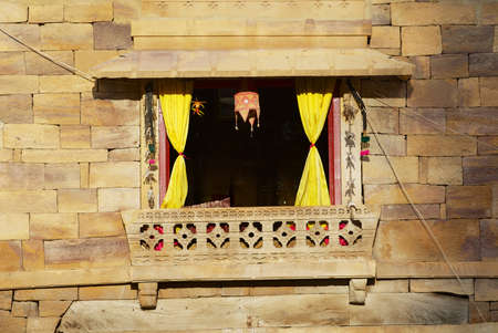 Window in the sandstone wall of the fort in Jaisalmer, India.