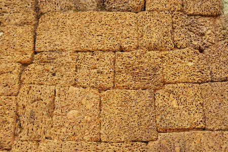 Sand stone wall at the ruins of the East Mebon Temple in Siem Reap, Cambodia.