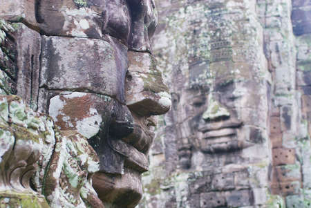 Stone carved faces at the wall of the Bayon temple in Siem Reap, Cambodia.