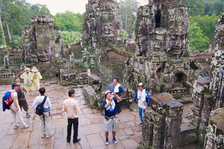 Siem Reap, Cambodia - August 08, 2008: Unidentified tourists visit Bayon temple in Siem Reap, Cambodia. Editorial