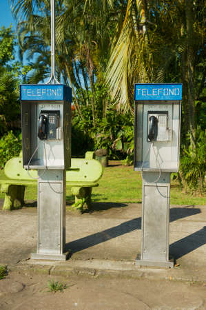 Tortuguero, Costa Rica - June, 20, 2012: Two telephone booths at the main street of the Tortuguero town, Costa, Rica.