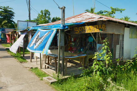 Tortuguero, Costa Rica - June 20, 2012: Souvenir shops in the town of Tortuguero, Costa Rica. Tortuguero is the base town for tourists to explore Tortuguero National Park. Editorial