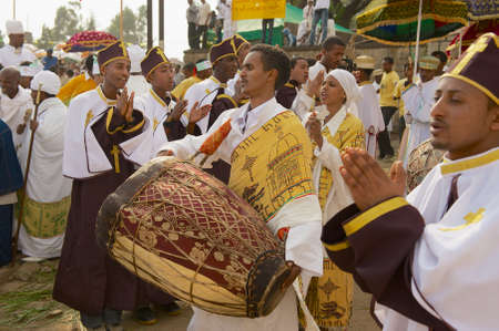 Addis Ababa, Ethiopia - January 19, 2010: Ethiopian priests celebrate Timkat religious Orthodox festival playing music and dancing at the street in Addis Ababa, Ethiopia.